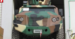 Prof Narcisse Mouelle, Cameroon's Minister of Sports stepped down from the trunk of this special military armoured vehicle.